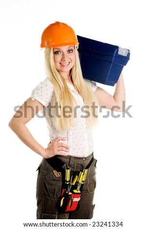 Girl, the builder bears a box with tools - stock photo