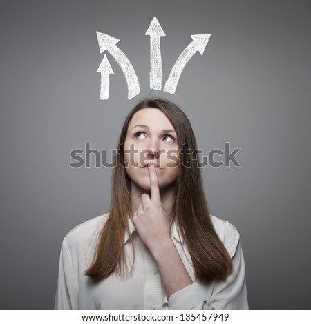 Girl thinking a solution. Girl full of doubts and hesitation. - stock photo