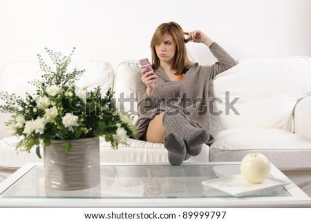 Girl thinking to call her boyfriend - stock photo