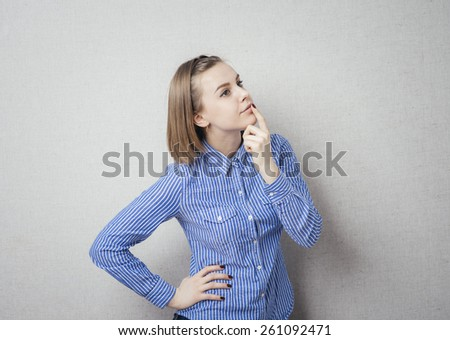 girl, thought and put a finger to her lips - stock photo
