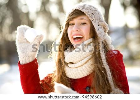 Girl throwing a snowball - stock photo