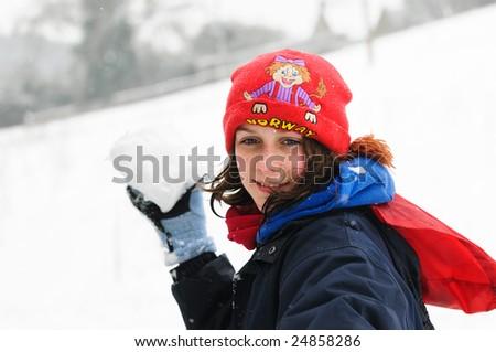 girl throwing snowball - stock photo