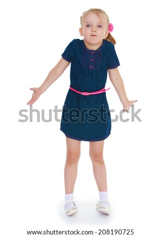 girl throws up his hands wondering.kindergarten, the concept of childhood and joy, teens - stock photo