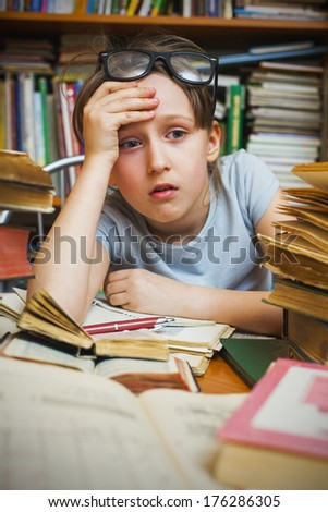 Girl tired of learning lessons - stock photo