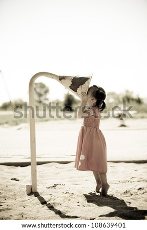 girl toddler is having fun in the playground - stock photo