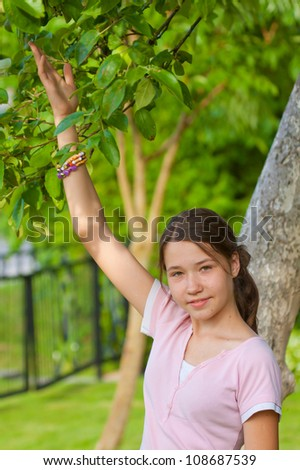 Girl touching leaves, connection with nature