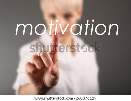 Girl touching screen with motivation business concept - stock photo