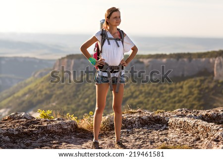 girl tourist in mountains