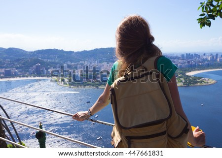 girl tourist  looks at Rio landscape from the Pao do Asucar viewpoint