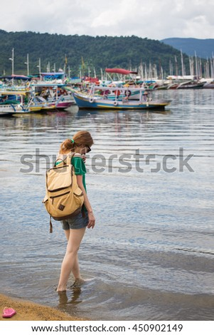 girl tourist walking on a beach at Paraty Brazil
