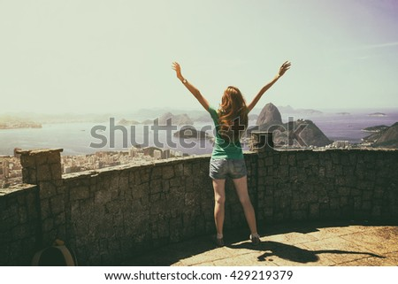 girl tourist with a backpack on the background Rio de Janeiro. view on Pao de Acucar - stock photo