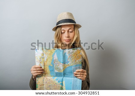 Girl tourist with map