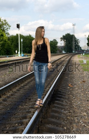 Girl traveling by railroad - stock photo