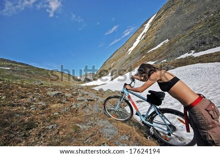 Girl traveling in the high mountains. #5. Wide angle. - stock photo