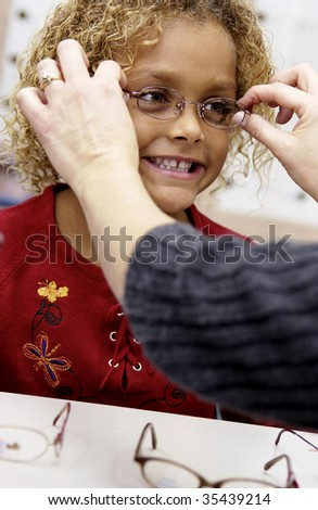 girl trying on glasses - stock photo