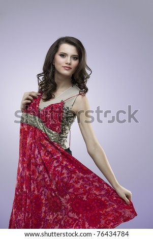 girl trying red fower dress posing - stock photo