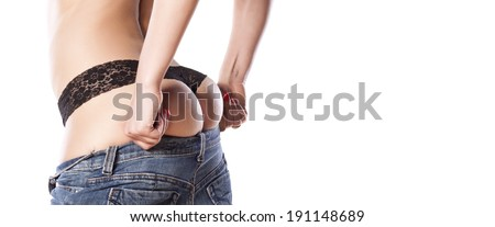 girl trying to dress her tight jeans - stock photo