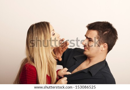Girl trying to kiss a guy  - stock photo