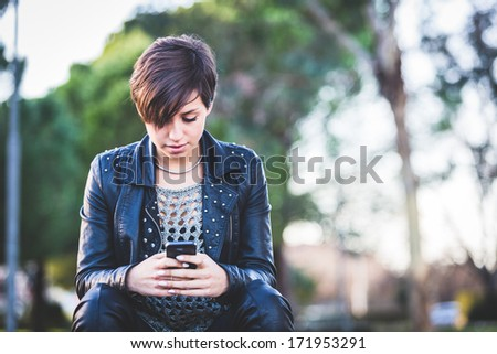 Girl Typing on Mobile Phone - stock photo