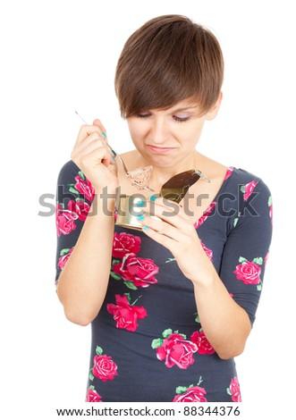 girl unlocks canned food, white background - stock photo