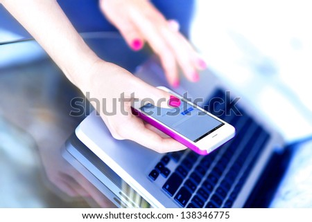 Girl use smart phone and laptop - stock photo