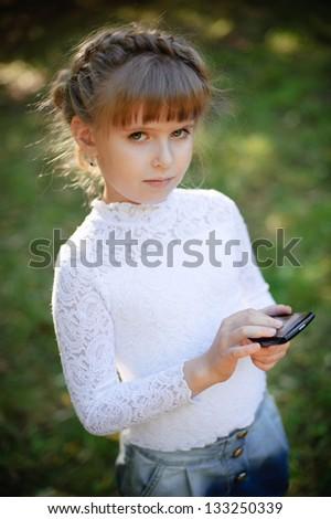 girl uses touchscreen phone - stock photo
