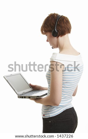 Girl using a laptop - stock photo