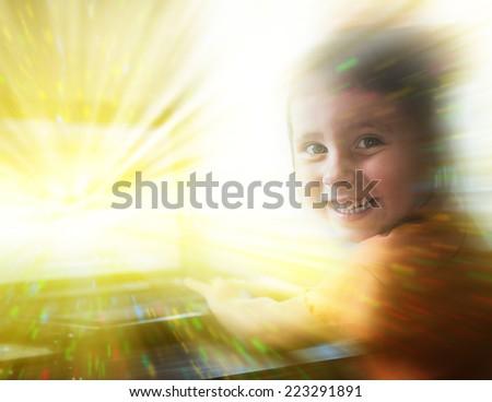 Girl using a laptop computer - stock photo