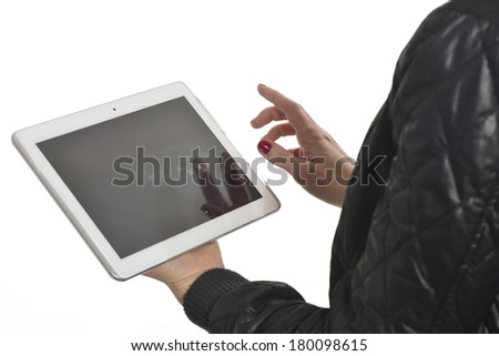 Girl using a tablet on white background - stock photo