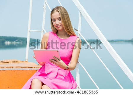 Girl using a tablet pc sitting