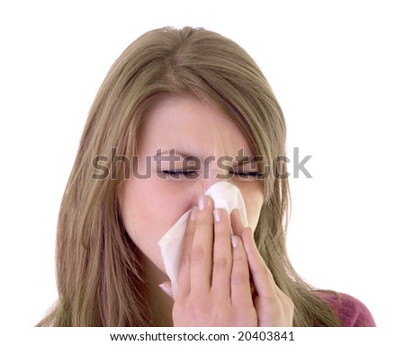 Girl using a white tissue to clean nose