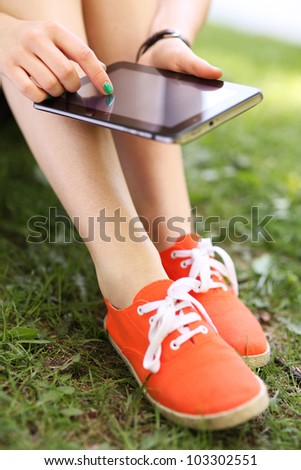 Girl using digital tablet - stock photo