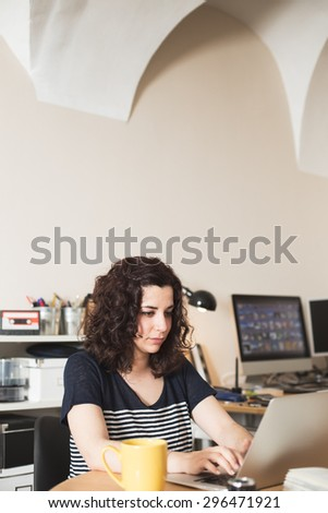 Girl using her laptop at home. - stock photo