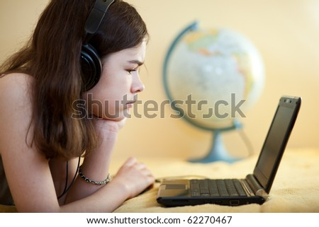 Girl using laptop at home - stock photo