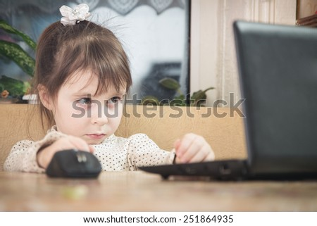 Girl Using Laptop in the room.