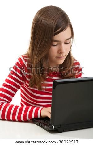 Girl using laptop isolated on white background - stock photo