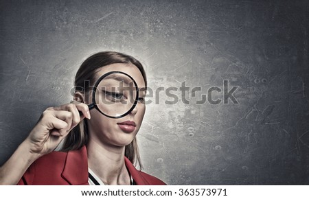 Girl using magnifier for search