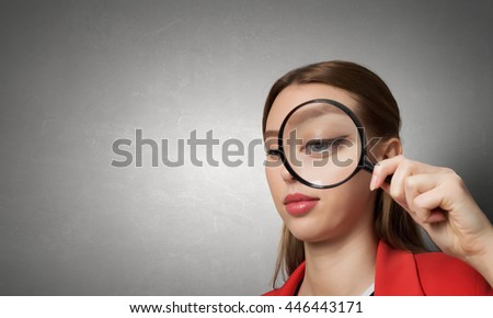 Girl using magnifier for search . Mixed media