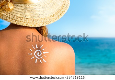 girl using sunscreen to safe her skin healthy, sun tanning, skin care and protection, vacation - stock photo