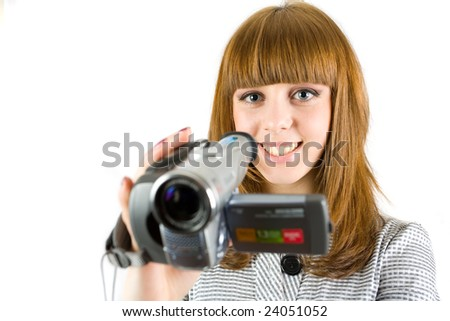 Girl using video camera (camcorder), isolated on white background