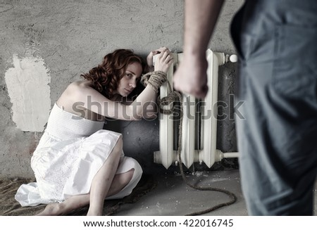 girl violence with hands bound  - stock photo