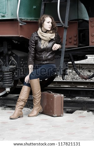 girl waiting for landing on the platform in the vintage train - stock photo