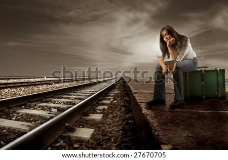 girl waiting train - stock photo
