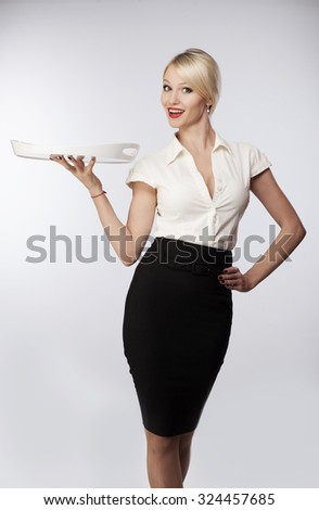 Girl waitress with a tray on a gray background - stock photo