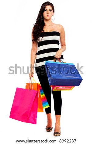 girl walking and carrying shopping bags isolated over a white background