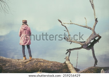 girl walking at the outdoors by the sea - stock photo