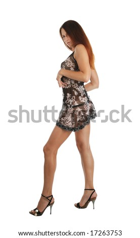 Girl walking in short dress with bright flower pattern, open-toe shoes high-heeled, isolated on white, side view - stock photo