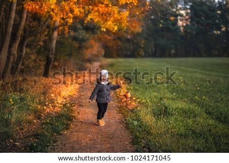 girl walking in the forest in autumn
