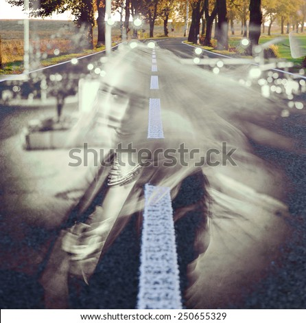 Girl walking on the night city street in slow motion double exposure - stock photo