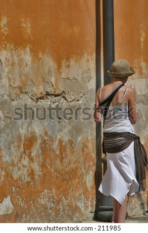 Girl walking out of the frame - stock photo